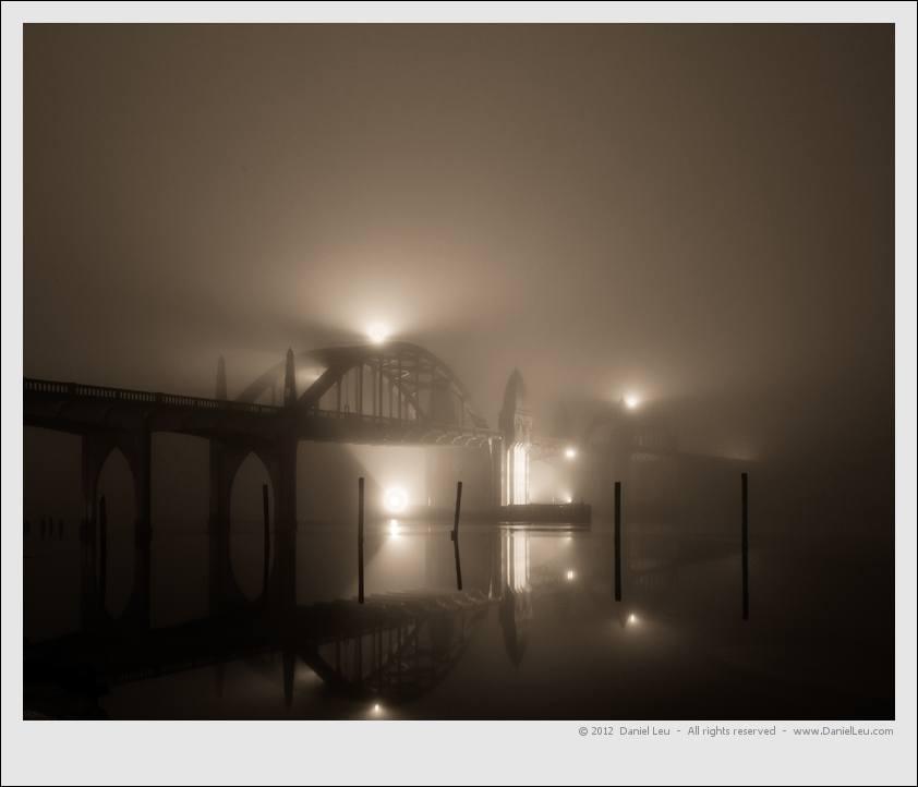Siuslaw river bridge covered in fog