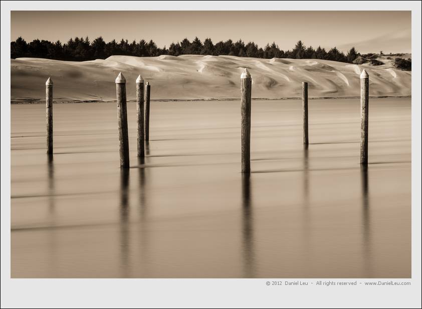 Siuslaw river pylons and sand dunes