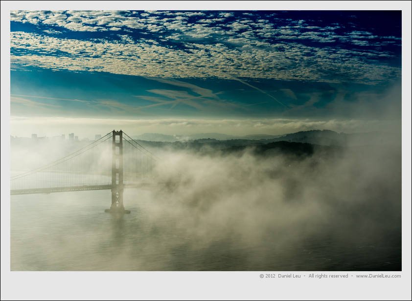 Golden Gate Bridge, fog, clouds, blue sky and morning light, what else do we need?