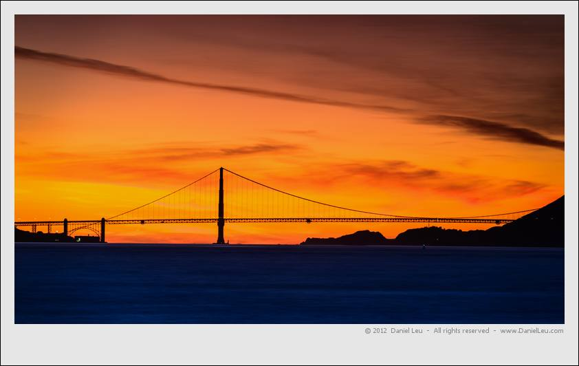 Golden Gate Bridge with orange sunset