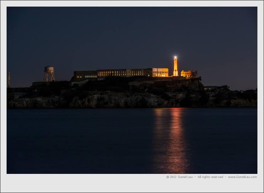Alcatraz Island lighthouse shining in orange.