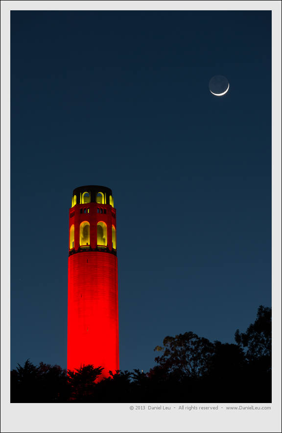 Red Coit Tower with crescent moon