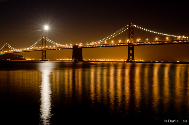 Reflection with Bay Bridge and full moon