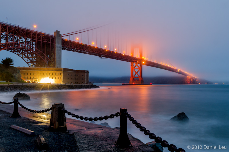 Fort Point and fog covered Golden Gate Bridge