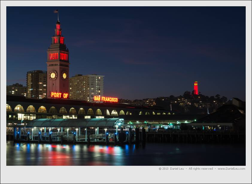 Ferry Building and Coit Tower shining in red