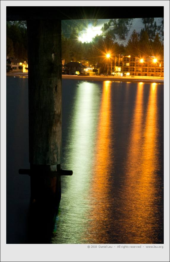 Lights reflecting underneath the pier